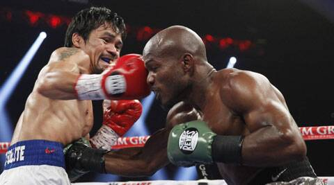 Pacquiao (L) claimed the WBO welterweight title with the win (AP)
