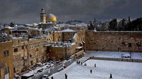 File photo of the Western Wall, right, and the gilded Dome of the Rock, among the holiest sites for Jews and Muslims. (AP)