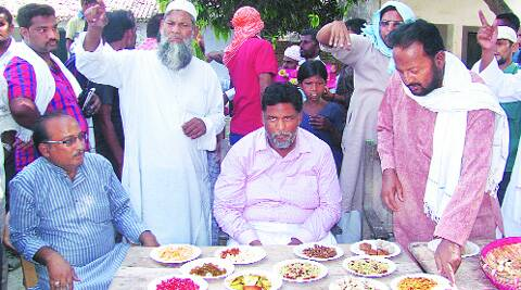 Pappu Yadav samples from plates spread out before him.express
