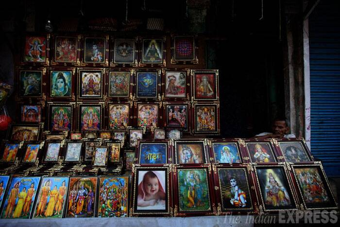 A shop selling photo frames of Hindu Gods in Ayodhya. (IE Photo: Tashi Tobgyal)