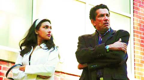 Rituparna Sengupta and Sabyasachi Chakraborty, in a still from Piyalir Password