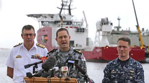 Royal Australian Navy Commodore Peter Leavy, center, commander of joint task force 658, accompanied by U.S. Navy Captain Mark Matthews, right, and Chief of the Royal Australian Navy Vice Admiral Ray Griggs, speak at a press conference at naval base HMAS Stirling about the Australian navy ship Ocean Shield. (AP)