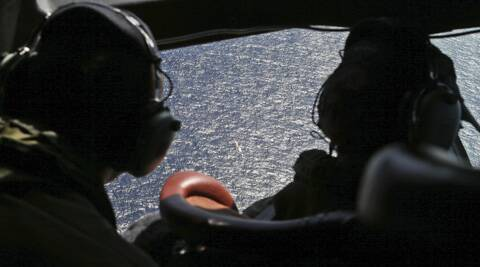 Officers of the multinational search for the missing Malaysia airlines look out the cockpit windows during search operations of Flight MH370 in the southern Indian Ocean. (AP)