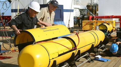 Searchers have extended the search beyond the normal 4,500 metre depth range of the mini-submarine. (AP)