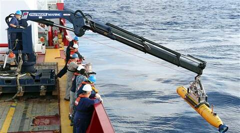 Malaysia to release MH370 report as plane search continues