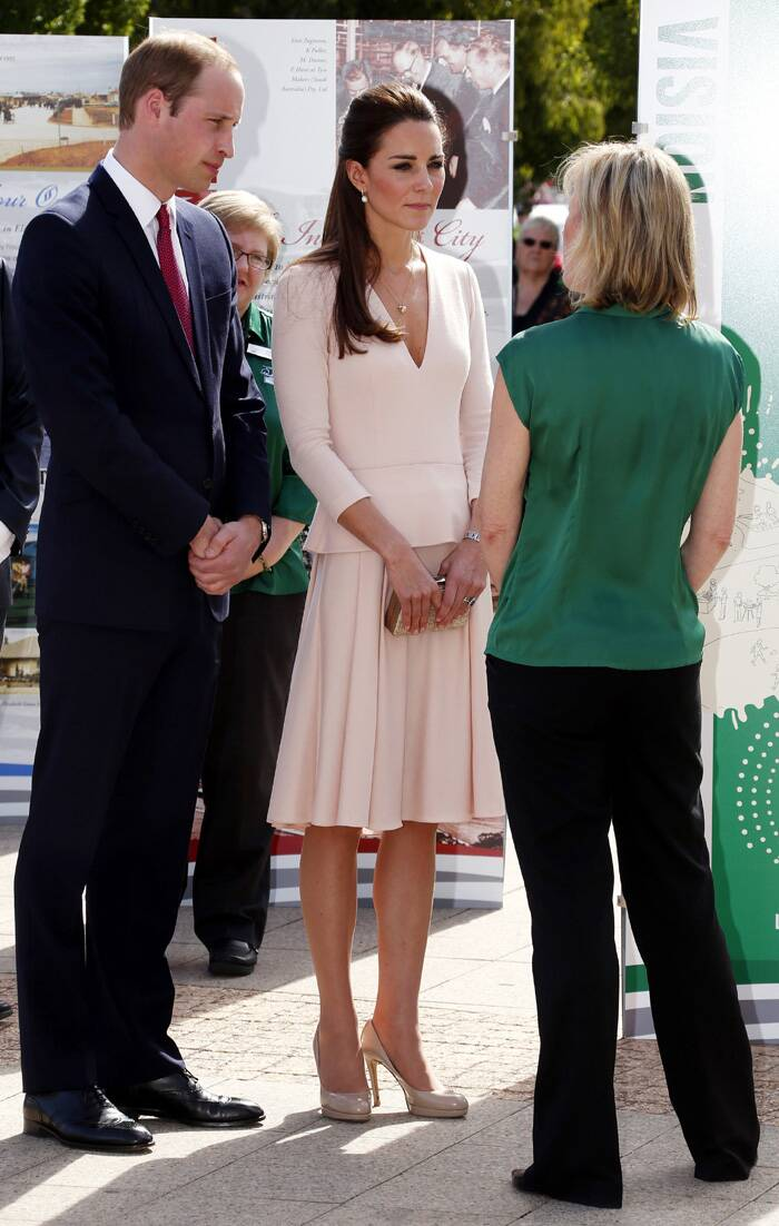 Prince William and Kate listen to a local official outside the Playford Civic Centre in the Adelaide suburb of Elizabeth. (Reuters)