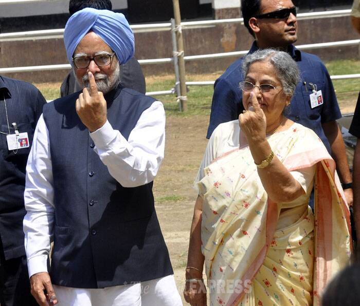Prime Minister Manmohan Singh and his wife Gursharan Kaur showing the ink mark on their fingers after casting votes for Lok Sabha polls at Dispur in Assam on Thursday. (IE Photo: Dasarath Deka)