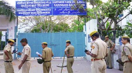 Police outside the school in Jahangirpuri in Northwest Delhi on Tuesday. (Express)