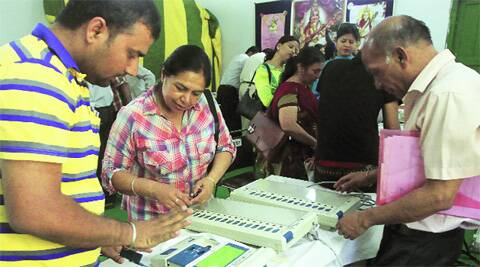A polling officer clears doubts regarding electronic voting machines on Wednesday. (Photo: Prem Nath Pandey)