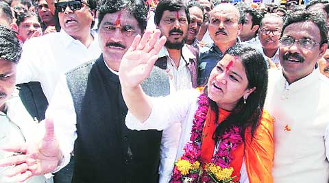 BJP leader Gopinath Munde (left) accompanies Poonam Mahajan to the collector's office in Bandra.