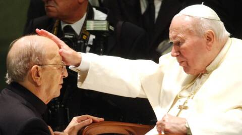 In this Nov. 30, 2004 file photo, Pope John Paul II gives his blessing to late father Marcial Maciel, founder of Christ's Legionaries, during a special audience the pontiff granted to about four thousand participants of the Regnum Christi movement. (AP)