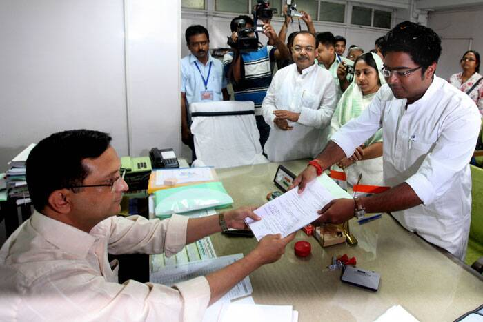 TMC Yuva president Abhishek Banerjee , nephew of CM Mamata Banerjee, filling his nomination for the elections on Monday. (Express photo by Partha Paul)