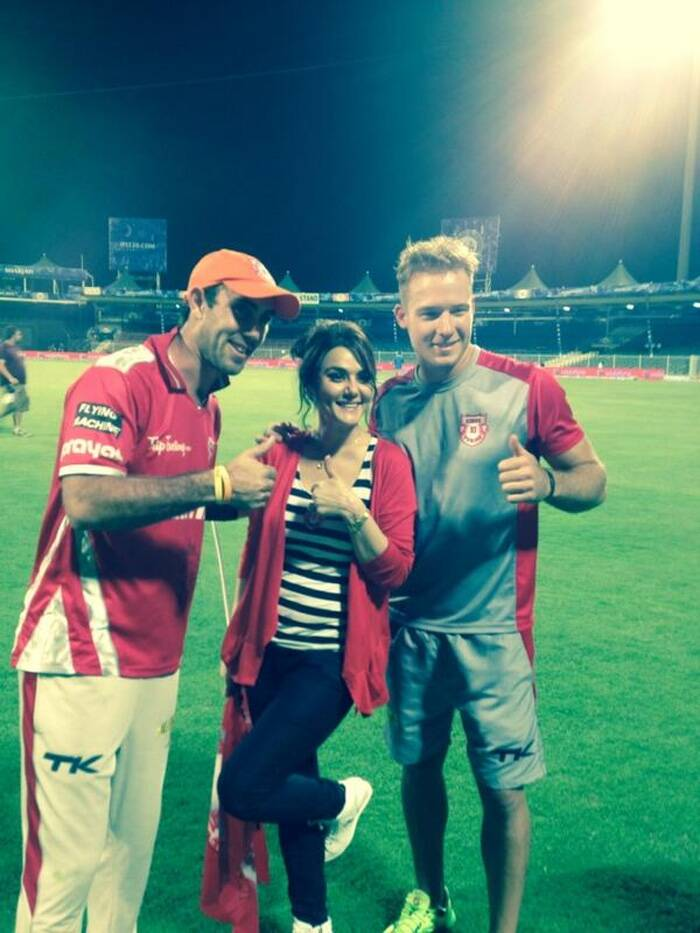 "Preity Zinta had tweeted, ""Red Lions roared loud tonight & it was a great team effort! Pujara was the perfect anchor, Maxwell & Miller thrilled the crowd & rocked it. Thank U Sharjah 4 all the Support 4 #KXIP tonight ! What a game... Ye ha! Cannot discount #RR 4 a great fight & 4 keeping my heart thumping.""<br />Preity Zinta seen here with the heroes of the match Maxwell & Miller. (Photo coutesy: Twitter @IPL)"