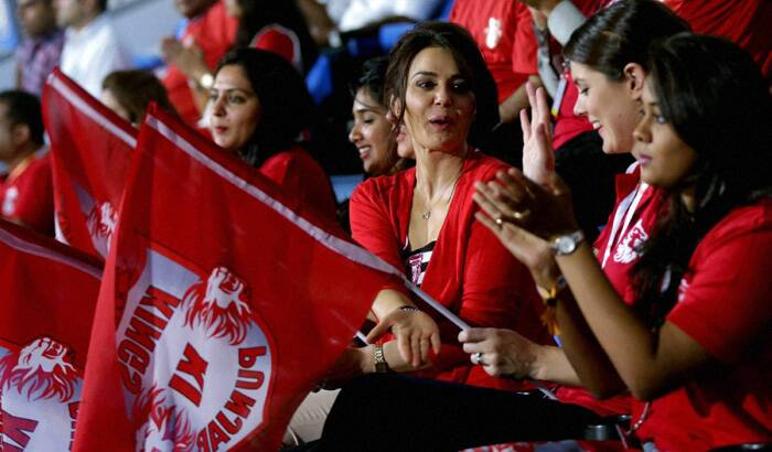 Bollywood actress and co-owner of Kings XI Punjab, Preity Zinta is on cloud nine after the victory of her team in the latest IPL 7 match against Rajasthan Royals in Sharjah, Dubai.<br /> A beaming Preity Zita waves her team's flag form the stands. (PTI/BCCI)