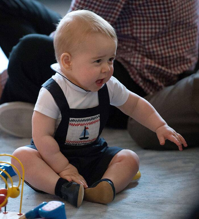 Prince George was dressed impeccably in a white collared T shirt with a navy blue dungaree featuring a sailboat. (AP)