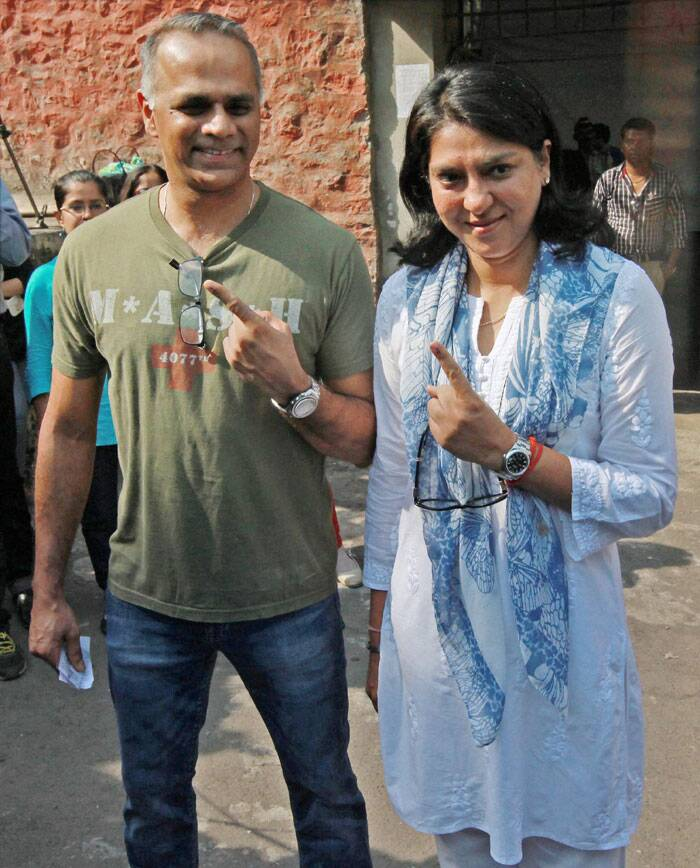 Congress candidate Priya Dutt along with her husband shows their inked finger after casting their vote for Lok Sabha elections Mumbai on Thursday. (PTI)