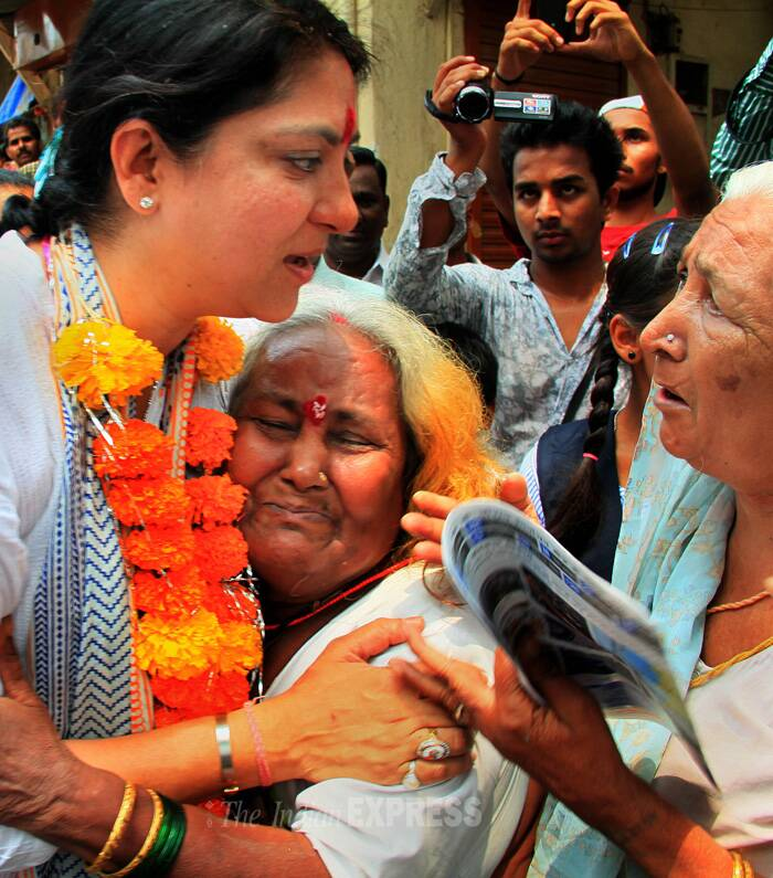 An old woman hugs Priya Dutt and cries as she conveyed her problems during the Congress MP's election campaign in Kherwadi Bandra east. (IE Photo: Amit Chakravarty)