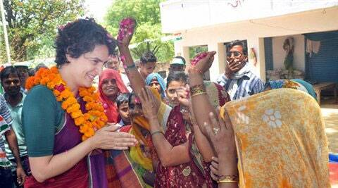Priyanka Vadra is greeted by women during her election campaign for her mother and Congress President Sonia Gandhi in Raebareli on Wednesday. (PTI)