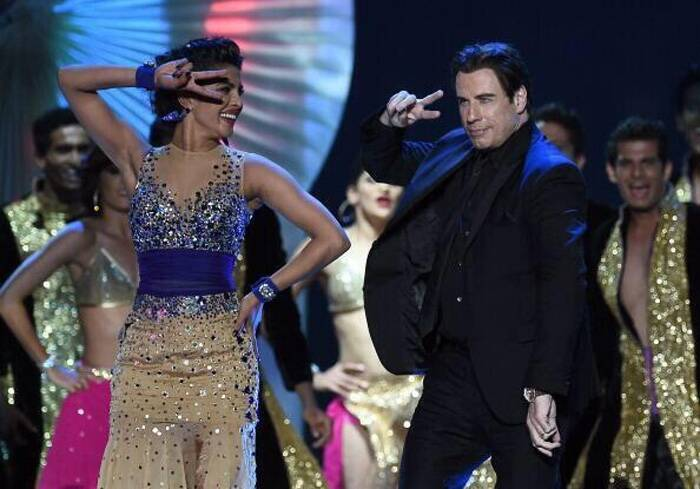 From Madhuri Dixit's 'thumke' to Ranveer Singh's high-octane performance – the 15th International Indian Film Academy (IIFA) awards made the jam-packed audience at Raymond James stadium shake a leg with their favourite Bollywood celebrities. <br /> During her performance, Priyanka Chopra got John Travolta on stage and the two danced on 'Tune Mari Entriyan' from 'Gunday'. (Photo: Twitter)