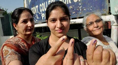 A girl, her mother and grandmother show their inked fingers after casting their votes at a polling station in Patiala on Wednesday. (PTI)