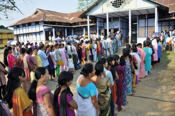 Voters stand in queue to cast their vote for Lok Sabha elections in West Bengal on Thursday. (PTI)