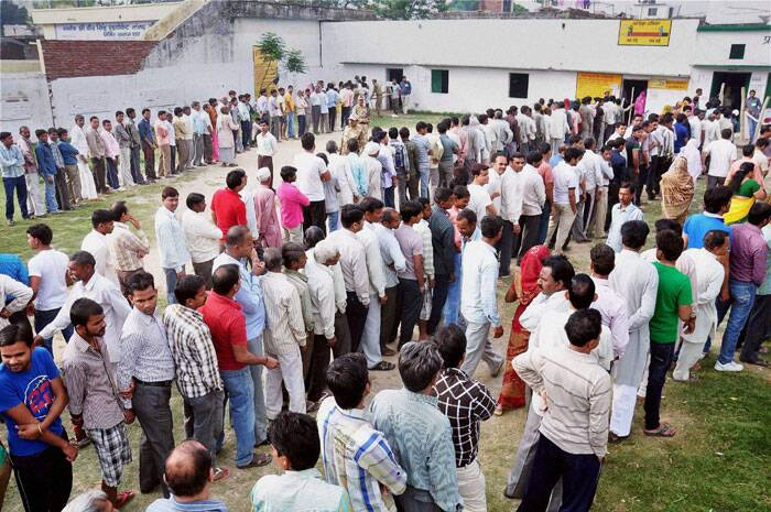Voters stand in queue to cast their vote in Moradabad on Thursday. (PTI)