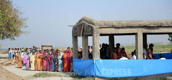 People stand in a queue to cast their vote for the ongoing Lok Sabha Elections 2014 in Bihar. (IE Photo: Alok Jain)