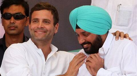 Congress Vice President Rahul Gandhi with DPCC chief Arvindar Singh Lovely during an election campaign rally in New Delhi on Sunday.  (PTI)