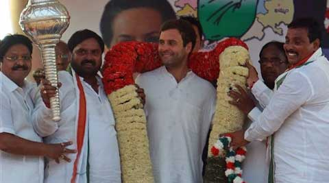 Rahul Gandhi  receives a giant garland during an election rally in Hyderabad. (PTI)