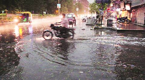 A waterlogged road after the shower in Ahmedabad on Sunday.  (Photo; Javed Raja)