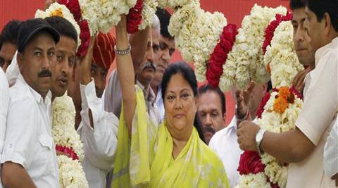 FILE PHOTO: Rajasthan Chief Minister Vasundhara Raje is garlanded during a public meeting in Ajmer. (PTI)