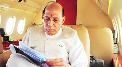 Rajnath on board his chartered flight. PTI