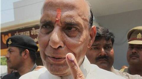P President and candidate Rajnath Singh shows his inked finger after casting vote for Lok Sabha polls in Lucknow on Wednesday. (PTI)