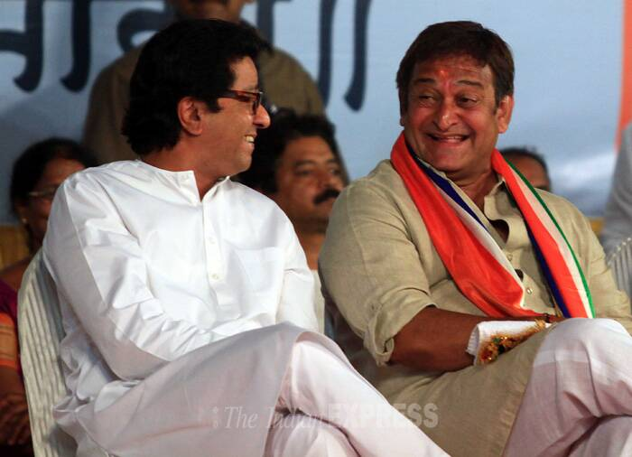 """However, I don't understand one thing. It was Munde who till the other day was saying that he did not need MNS support. But the same Munde phones me this morning to seek my backing,"" Raj said. <br />Raj Thackeray seen here with MNS Mumbai North-West contestant Mahesh Manjrekar. (IE Photo: Amit Chakravarty)"