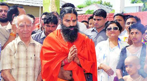 BJP leader Shanta Kumar with Ramdev in Kangra.