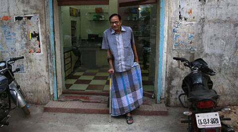 In this April 15, 2014 photo, India's Ramesh Agrawal walks outside his shop during an interview in Raigarh in Chhattisgarh state, India. (AP)