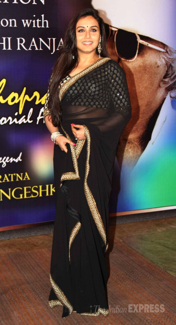 For the Yash Chopra National Memorial Award presentation, Rani Mukerji was a gorgeous sight in a black sheer sari with a rich gold border paired with a three-quarter sleeved blouse.