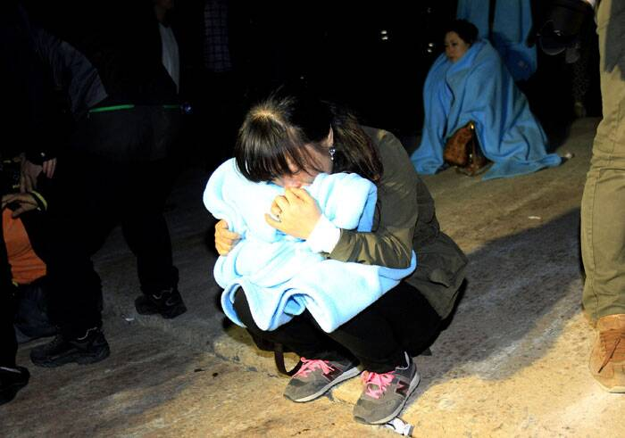 Relatives of the three dead students wailed and sobbed as ambulances at a hospital in Mokpo, a city close to the accident site, took the bodies to Ansan. (AP)