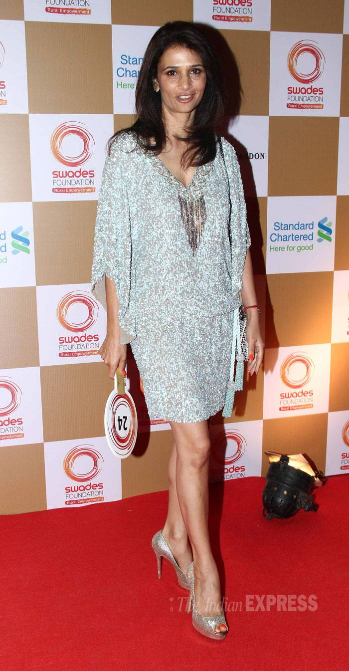 Leander Paes' wife, Rhea Pillai opted for a short number with peep-toes. (Photo: Varinder Chawla)
