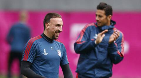 Bayern Munich's Franck Ribery (L) attends a training session in Munich on Monday. (Reuters)