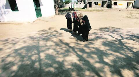 Women voters leave a polling station in Joula on Thursday. (Photo: Oinam Anand)
