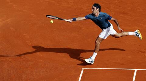 Roger Federer beat an injured Novak Djokovic 7-5 6-2 to set up an all-Swiss Monte Carlo Masters final with Stanislas Wawrinka. (Reuters)
