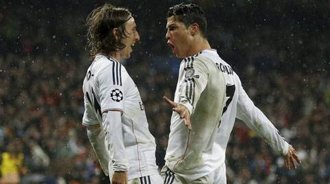 Real Madrid's Cristiano Ronaldo, (R), celebrates with Luka Modric after scoring his side's 3rd goal against Borussia Dortmund on Wednesday. (AP)