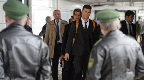 Cristiano Ronaldo (C), the Champions League top scorer with 14 goals this season, arrives in Munich ahead of Real's semifinal. (AP)