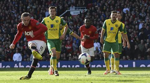 Manchester United's Wayne Rooney (L) scores a penalty against Norwich during their English Premier League soccer match at Old Trafford in Manchester (Reuters)