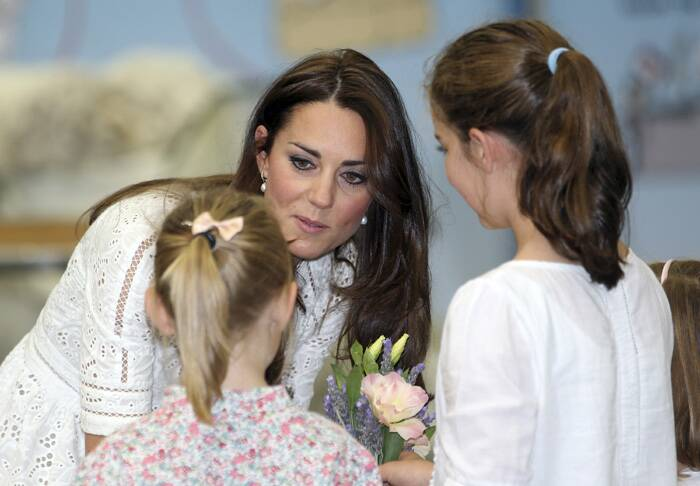 Kate speaks to two young girls during a visit to the Royal Easter Show in Sydney. (AP)