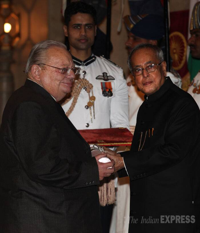 Famous personalities from all walks of life were awarded with the fourth highest civilian award, Padma Shri , by President Pranab Mukherjee on Saturday. <br /> Author Ruskin Bond receives his Padma Shri Award from President Pranab Mukherjee at the Rashtrapati Bhawan on Saturday. (IE Photo: Renuka Puri)