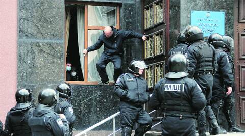 Masked pro-Russian activists seize the regional prosecutor's office in Donetsk Saturday. AP