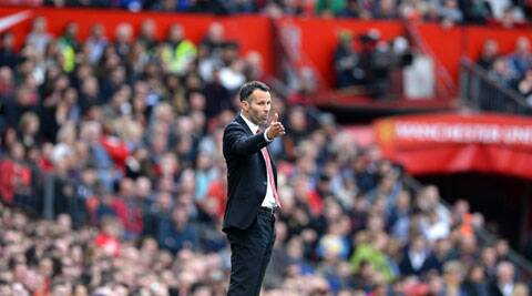 Manchester United coach Ryan Giggs reacts during their English Premier League soccer match against Norwich at Old Trafford in Manchester (Reuters)