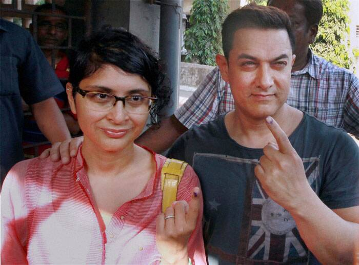 Bollywood actor Aamir Khan shows his inked finger with his wife Kiran Rao during the sixth phase of polling in Mumbai. (PTI)